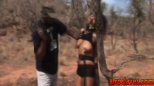 African slave gets abused by masters outdoors