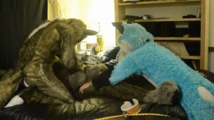 fursuit 1 people in animal costumes caress each other