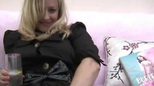 Pleasant blonde in black sexy stockings Stocking Tease
