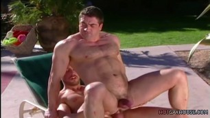 Muscled daddy rides cock outdoor