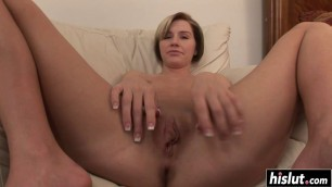 Pretty Kelly stretches her shaved pussy