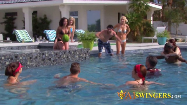 Brett and Laura play at the pool with other horny couples before partying