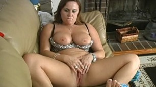 Lesbian babes masturbate together on their couch