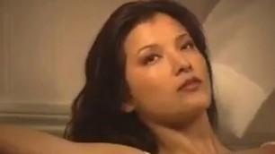 Kelly Hu topless in Maxim Magazine