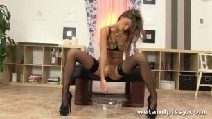 Super hot brunette peeing in a super bowl