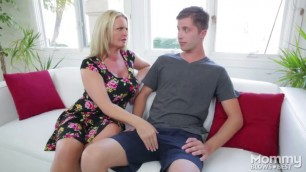 Busty blonde MILF with big tits giving a deepthroat to a stepson's big cock