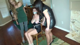 Dominatrix tied up by Milf and girl