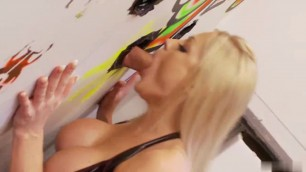 Busty Cindy uses glory hole while she rubs her clit in the toilet