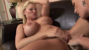 Brunette lesbian teases blondes clit with a toy while fingering her